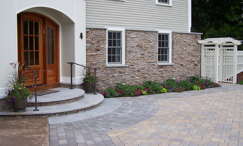 front arrival landscape design with hardscapes